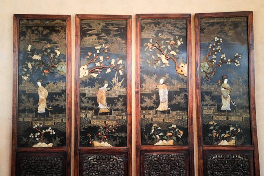 A four-panel Chinese hard stone and carved wood screen, which likely depicts the four seasons, is among the items from the estate of Jim Houston that will be available for sale beginning July 19.