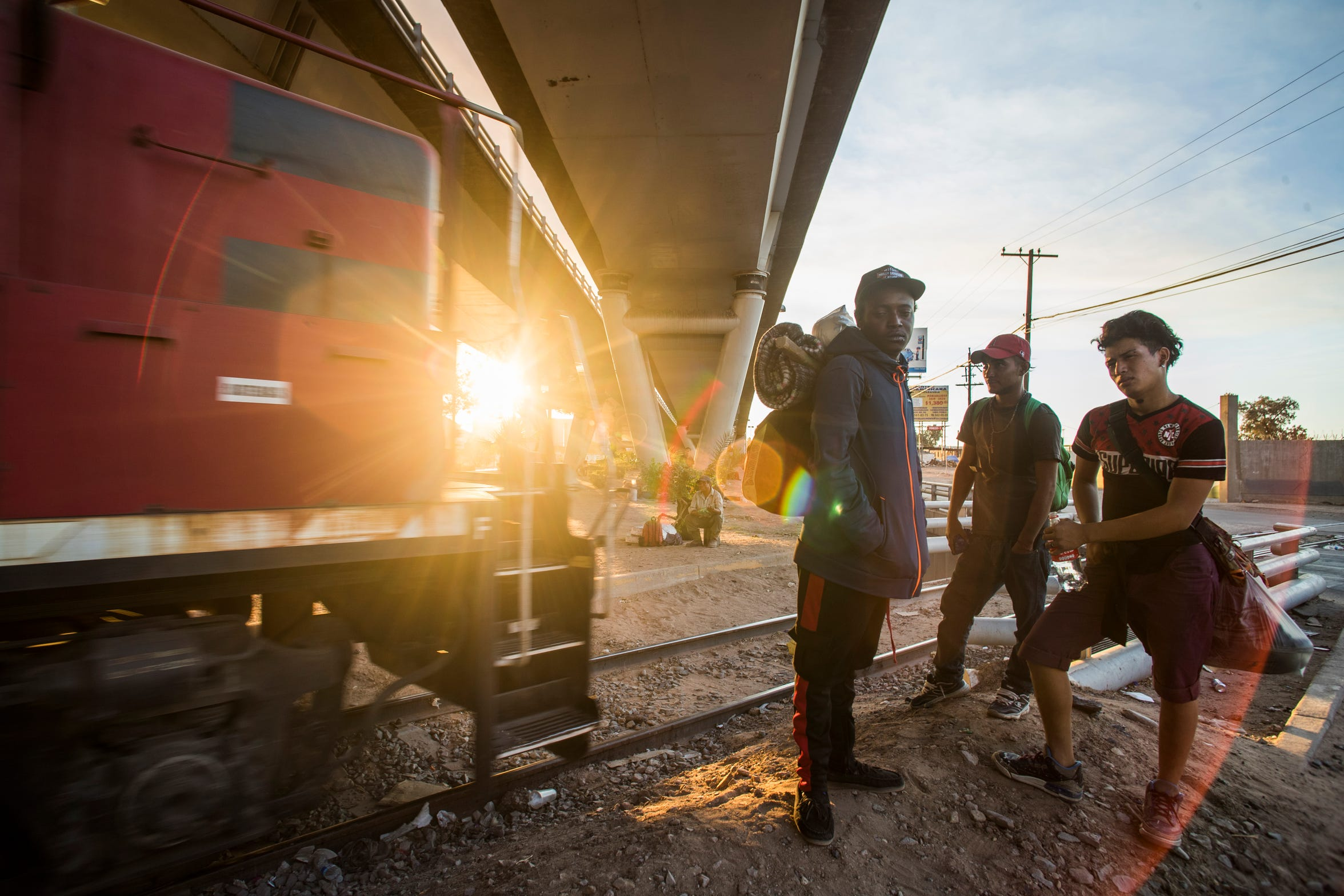 No longer willing to stay in Mexico while they wait for a hearing regarding their requests for asylum in the United States, these young Honduran migrants decide to return to Honduras by jumping a train.