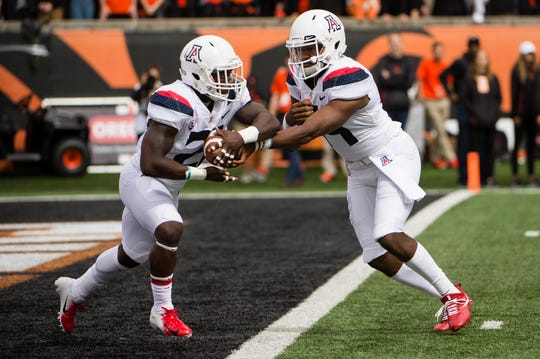Arizona Wildcats quarterback Khalil Tate (14) hands the ball off to running back J.J. Taylor (21) during the first half against the Oregon State Beavers at Reser Stadium.