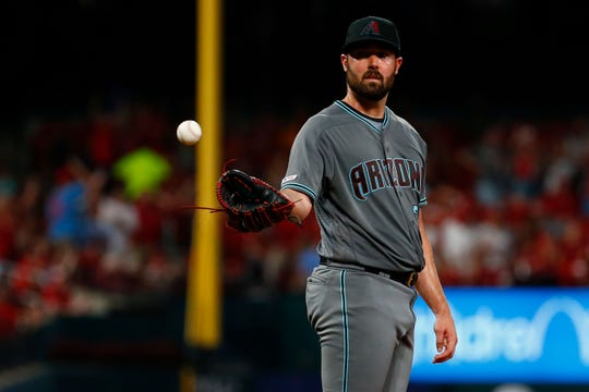 Robbie Ray #38 of the Arizona Diamondbacks reacts after giving up a home run against the St. Louis Cardinals in the fifth inning at Busch Stadium on July 12, 2019 in St Louis, Missouri.
