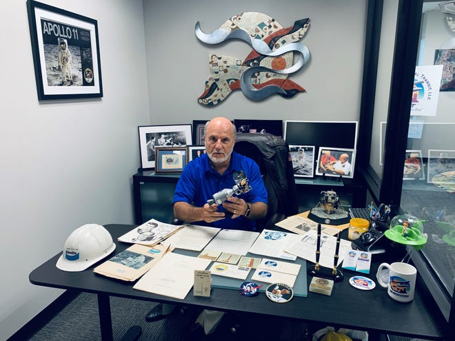 Tom Nocera's office is adorned with NASA memorabilia from his days as a trainee engineer working on the launch of Apollo 11.