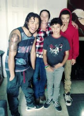 Jordan Maxie, his mother and two brothers