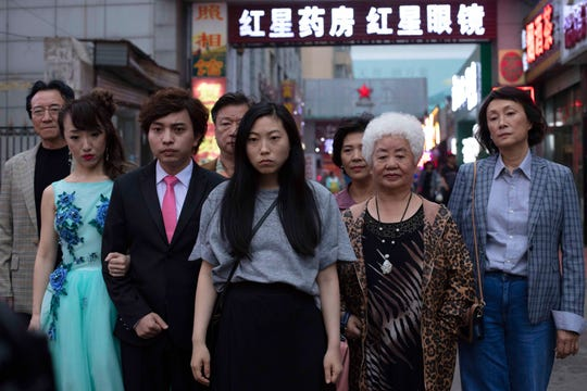 "Awkwafina (middle) stars as Billi, a Chinese-born, U.S.-raised woman who reluctantly returns to Changchun to find that, although the whole family knows their beloved matriarch, Nai Nai (grandma), has been given mere weeks to live, everyone has decided not to tell Nai Nai herself in ""The Farewell."""