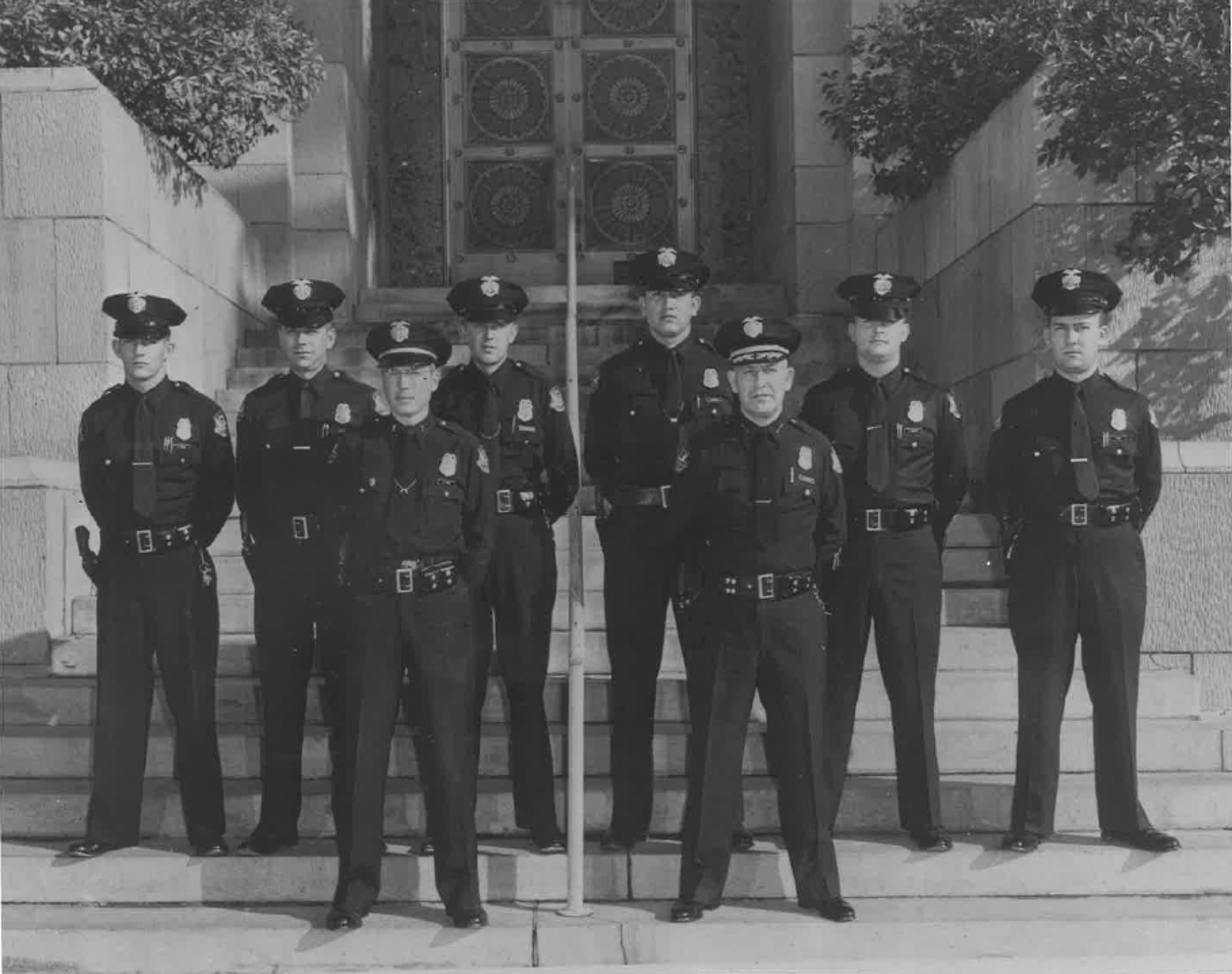The Phoenix Police Academy class of 1958 poses for a photo. Manny Quiñonez is fourth from the left in the back row.