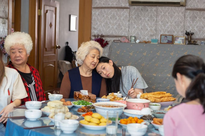 "Billi (Awkwafina) shares a tender moment with her grandmother Nai-Nai (Shuzhen Zhao) in ""The Farewell."""
