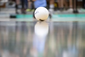 A volleyball on the court.