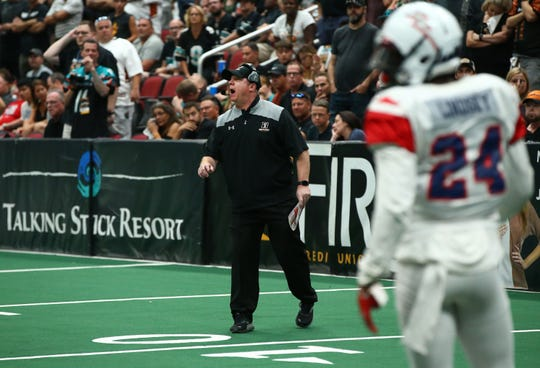 Arizona Rattlers head coach Kevin Guy calls a play against the Sioux Falls Storm in the second half during the United Bowl on July 13, 2019 at Gila River Arena in Glendale, Ariz.