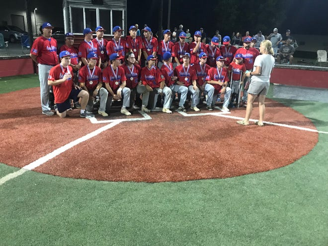 The Campbelltown Legion baseball team gets set to pose for photos after capturing the Lebanon County title on Monday night with a 7-6 win over Ephrata at In The Net.