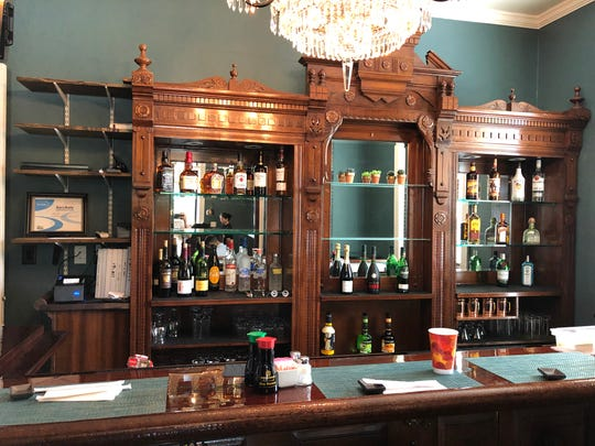 A peek inside the renovated Misago Bistro, which replaced the Inn 422, but kept its old antique bar.