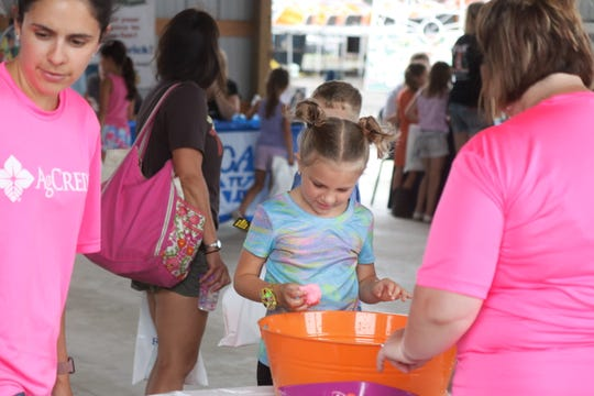 "With Tuesday being ""Money Day"" at the Ottawa County Fair, local kids had the chance to learn about that area's various community banks from them directly and have fun in the process."