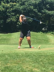 Marianna Monaco takes a swing during the Duthcess County Women's Amateur golf tournament last weekend.