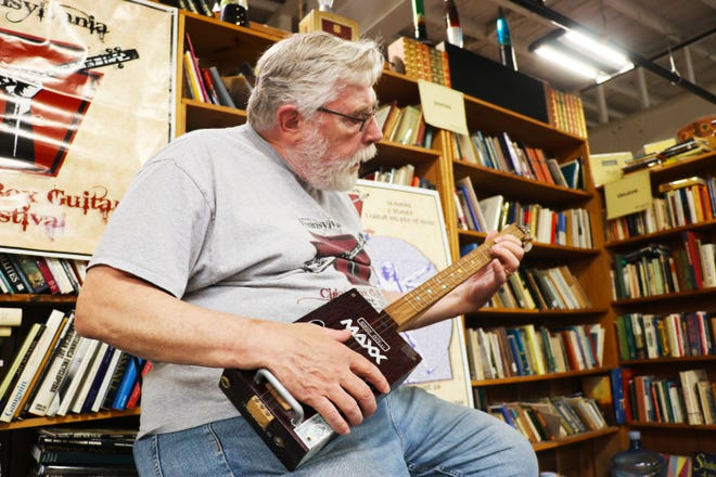 Jim Lewin, the owner of The York Emporium, contacted Guinness World Records to attempt a new record for the world's largest cigar box guitar ensemble.