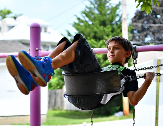 Josh Bean, 9, of Spring Garden Township, swings at Grantley Park in Spring Garden Township, Tuesday, July 16, 2019. Dawn J. Sagert photo
