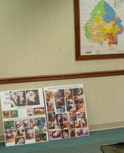 A pair of photo boards showing Kevin and LuLu sit under a map of Manchester Township at a recent zoning board hearing.
