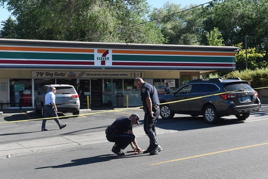 Police investigate the scene of an officer-involved shooting at a 7-Eleven store on Mt. Rose Street in Reno on July 15, 2019.