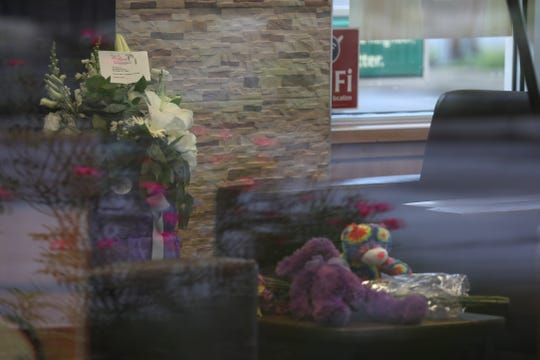 Makeshift memorials of flowers and stuffed animals for 3-year-old Bryce Raynor sit inside the University Avenue  Tim Hortons.