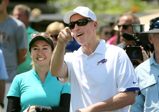 Former Bills quarterback Jim Kelly shares a laugh with Symetra pro Jillian Hollis during the Celebrity Golf Scramble at the Danielle Downey Credit Union Classic.