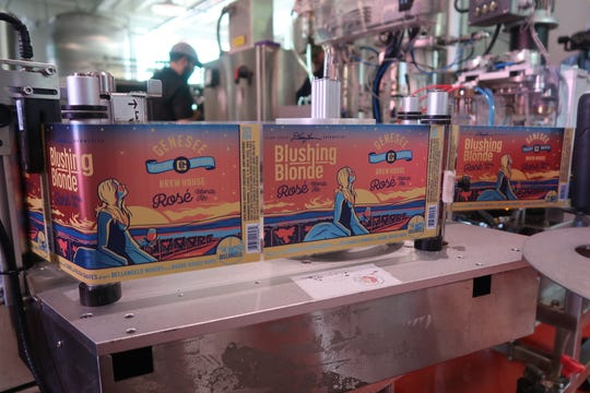 Labels for the Genesee Brew House Blushing Blonde Rosé Ale waiting to be affixed to cans as the beer is packaged Tuesday.
