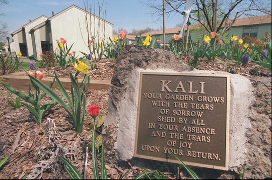 A plaque to Kali Ann Poulton is set in a flower bed at Gleason Estates in East Rochester in 1996.