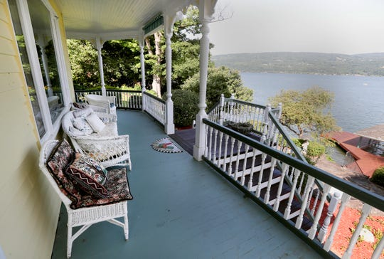 An upper level porch that leads down to the patio and dock area.