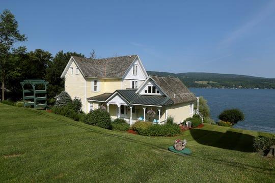 The house sits along the east side of Canandaigua Lake