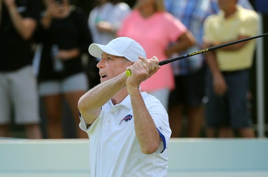 Former Bills quarterback Jim Kelly plays the 10th hole during the Celebrity Golf Scramble at the Danielle Downey Credit Union Classic.