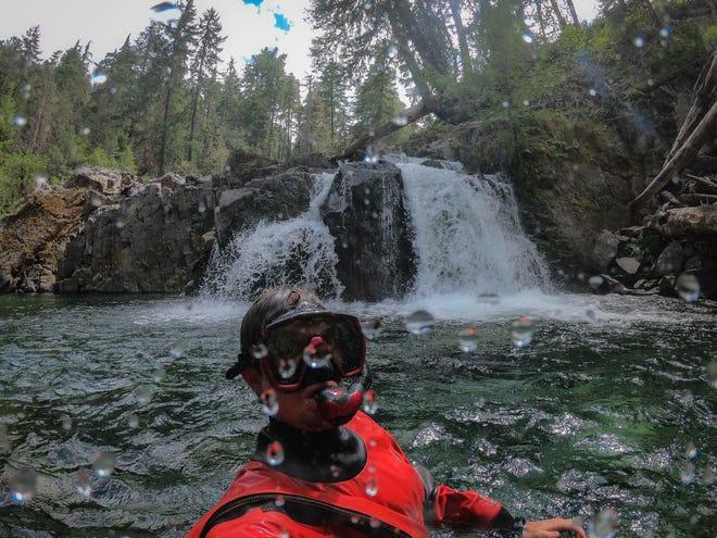 Zach Urness snorkeling near a waterfall on Elk Lake Creek in Bull of the Woods Wilderness.