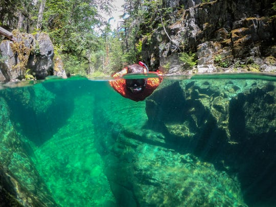 Zach Urness explores below the surface of Elk Lake Creek in the Bull of the Woods Wilderness.