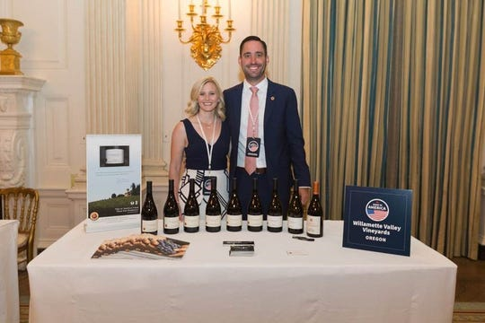 Christine Clair and Jim Clair show a selection of Willamette Valley Vineyards and Oregon Solidarity wines in the State Dining Room of the White House on July 15, 2019, at the Made in America Product Showcase event.