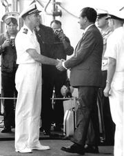 Captain Carl Seiberlich greets President Richard M. Nixon aboard USS Hornet during the Apollo 11 recovery on July 24, 1969.