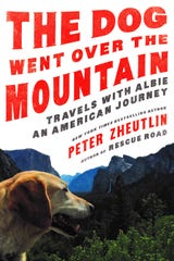 The Dog Went Over the Mountain: Travels with Albie: An American Journey was written by Peter Zheutlin.