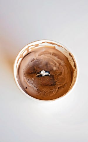 An engagement ring is shown inside Jocelyn's Chocolate Cheesecake ice cream, a special flavor created by Scott Clemmer at  The Latest Scoop, 37A W. Concho Ave. The flavor was made to celebrate his niece's engagement, which also happened at the shop on Sunday, July 14.