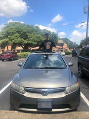 U.S. Marine Brandon Short in his new car that a San Angelo man, Sam Gomez, helped him find after Short was involved in a car crash outside Sonora.