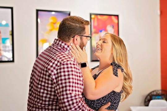 Jocelyn Owens smiles at Luke Midkiff after he proposed to her on Sunday, July 14, at The Latest Scoop, 37A W. Concho Ave.