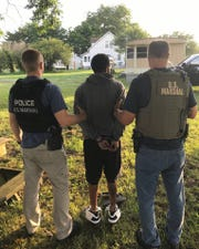U. S. Marshals take Jonathan Aviles-Alers into custody in Painter, Virginia on Friday, July 12, 2019.