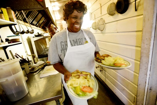 Tina Tasby has been a waitress at Jacquelyn's Cafe on Louisiana Ave. for 32 years, she says she loves it there.