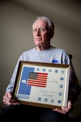 Gary Metz holds a flag that was sent to the lunar surface during the Apollo 17 mission. This flag was gifted to him by the director of NASA, Christopher Kraft for his involvement in the program.