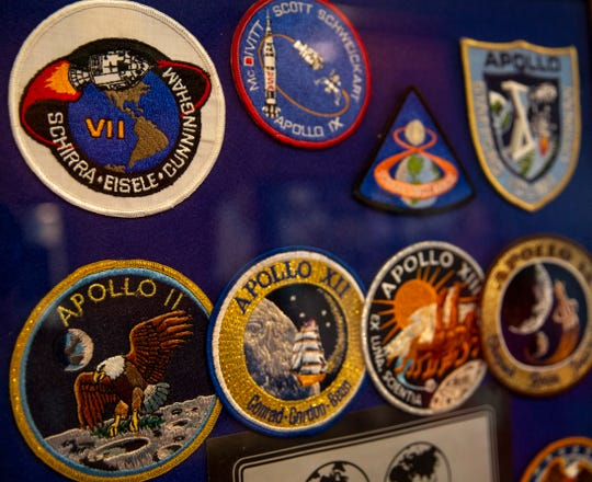 Patches designed by each Apollo crew are framed in Gary Metz's NASA memorabilia collection. This year marks the 50th anniversary of the Apollo 11 moon landing.