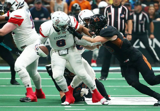 Storm quarterback Lorenzo Brown fights for yardage in Saturday's United Bowl