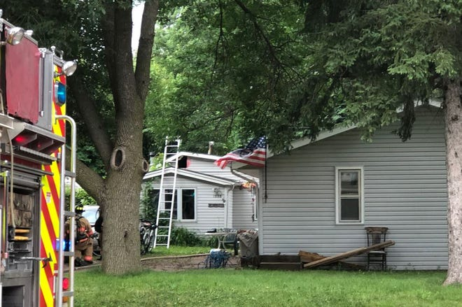 Firefighters cut a hole in the attic of a home at 1808 N. Jessica Ave. where a fire broke out on Tuesday, July 16, 2019.