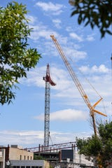 A crane is removed from the parking ramp located near 10th street, Tuesday, July 16.