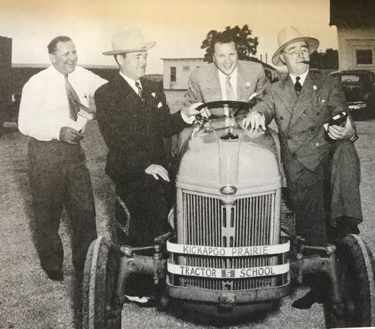 Lester E. Cox (left to right), Ernest R. Breech, Henry Ford II and Jack Davis pose with a tractor at the Kickapoo Prairie Farm -- where Chesterfield Village is now located -- on June 7, 1947.