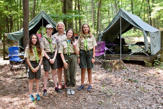 Members of all-girl Scouts BSA Troop 1138 (left to right) Kaylee Beirne, Allison Monfalcone, leader Julie Curry, Ginger Stewart and Sammie Curry pose at Camp Shenandoah on July 15, 2019.