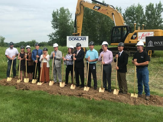 Gov. Walz, Sartell city officials, and Toppan Merrill leaders pose for the groundbreaking of the Toppan Merrill facility expansion in Sartell.