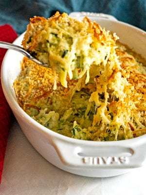 Easy Make Ahead Zucchini Gratin is topped with bread crumbs and Gruyere cheese.
