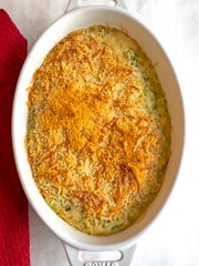 The key to this gratin is to grate the zucchini and onions, sprinkle them with some salt in a colander, and let them sit for about 30 minutes to remove excess water.