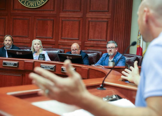 Vero Beach Mayor Val Zudans (from left), Councilwoman Laura Moss, Councilman Robert Brackett and Councilman Harry Howle listen as Leisure Square pool water aerobic instructor John Sammartano speaks in support of saving the pool during a City Council meeting at City Hall on Tuesday, July 16, 2019, in Vero Beach.