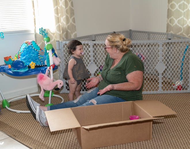 Madison plays with her mother Jessica on the floor of their new home. This single mom continues to thrive, thanks in large part to the support she gets from Mary's ShelterWomen in Transition program.