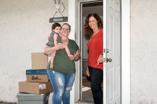 Gina Thompson, right, executive director of Mary's Shelter, is greeted by Jessica Bright and her daughter, Madison, at their new home. This single mom continues to thrive, thanks in large part to the support she gets from Mary's ShelterWomen in Transition program.