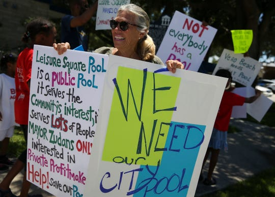 "Pat Holland, of Vero Beach, protests the closing of Leisure Square pool before a City Council meeting at City Hall on Tuesday, July 16, 2019, in Vero Beach. Holland attends a water aerobics class at the pool multiple times a week and believes the pool is an asset to the city. ""It's so important to the community,"" said Holland. ""When I think of Vero, I think of the pool."""